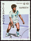"NICARAGUA - CIRCA 1987: A stamp printed in Nicaragua from the ""Capex 87. International Stamp Exhibition, Toronto "" issue shows tennis player, circa 1987. — Stock Photo"