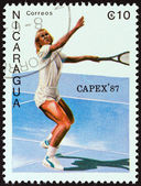 """NICARAGUA - CIRCA 1987: A stamp printed in Nicaragua from the """"Capex 87. International Stamp Exhibition, Toronto """" issue shows tennis player, circa 1987. — Stock Photo"""