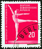 """GERMAN DEMOCRATIC REPUBLIC - CIRCA 1961: A stamp printed in Germany from the """"3rd European Women's Gymnastic Championships, Leipzig """" issue shows gymnast, circa 1961. — Stock Photo"""