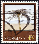 "NEW ZEALAND - CIRCA 1983: A stamp printed in New Zealand from the ""Paintings by Rita Angus "" issue shows Tree, circa 1983. — Stock Photo"