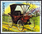 """PARAGUAY - CIRCA 1983: A stamp printed in Paraguay from the """"Antique Automobiles """" issue shows Peugeot-Daimler, 1894, circa 1983. — Stock Photo"""