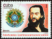 """CUBA - CIRCA 1988: A stamp printed in Cuba from the """"Latin American History (3rd series)"""" issue shows Coat of Arms and A. de Silva Xavier """" Tiradentes """" (Brazil), circa 1988. — Stock Photo"""
