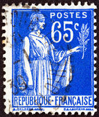FRANCE - CIRCA 1937: A stamp printed in France shows Peace allegory, circa 1937. — Stock Photo