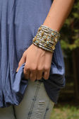 Leather bracelet with rhinestones on the arm of a young girl — Stock Photo