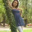 Slim petite young girl in park — Stock Photo #13194462