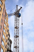 Crane on construction of a new home — Stock Photo