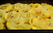 Baked potato slices with onion — Stock Photo
