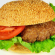 Burger with beef, tomato and bun with sesame seeds — Stock Photo