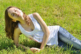 Young girl on green grass — Stock Photo