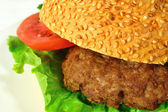 Burger with beef and vegetables close-up — Stock Photo