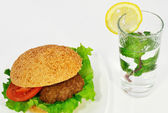 Hamburger and a glass of lemonade — Stock Photo