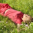 Young girl in the grass — Stock Photo