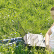Young girl sitting with a laptop on the grass — Foto Stock