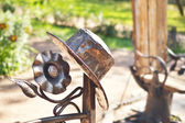 Iron decorations of the bench in a park — Stock Photo