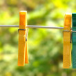 Clothespins on a rope in the yard — Stock Photo