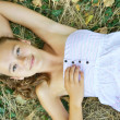 Young girl lying on the grass — Stock Photo #30732953