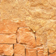 A piece of orange stone wall — Stock Photo