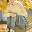 Stock Photo: Young girl sitting on parapet of stairs bright autumn da