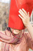 Girl and red gift bag — ストック写真