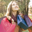 Young girl holding many gift packages — Stock Photo #39156053