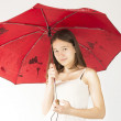 Teenage girl with a red umbrella — Stock Photo
