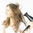 Black hair dryer and red hair — Stock Photo #39933527