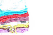 Lots of colorful women's scarves stacked in a pile — Stock Photo