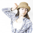 Stock Photo: Modest girl in shirt and hat