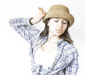Modest girl in shirt and hat — Stock Photo