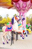Children's carousel in the park — Stock Photo