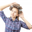 Teenage girl in hair curlers — Stock Photo #49051895