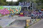 Graffiti, skate ,board, rollers, bicycle — Stock Photo
