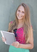 Beautiful smiling girl holding tablet computer — Stok fotoğraf