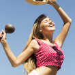 Dancing girl handling maracas and hat — Foto de Stock