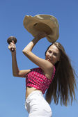 Happy longhaired girl dancing with maracas and hat — Stock Photo