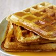 Постер, плакат: Stack of homemade waffles on the plate with sweet sauce on top