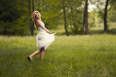 Girl running in the meadow — Stock Photo