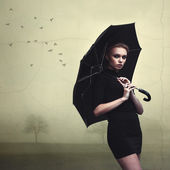 Beautiful girl portrait with umbrella — Stock Photo
