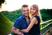 Boy with girlfriend smiling and look at the camera. Outdoor happy couple portrait — Stock Photo