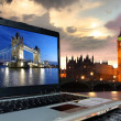 Big Ben with Tower Bridge on screen of notebook, London, UK — Photo #13156005