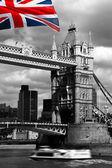 London, Tower Bridge with flag of England — Stock Photo