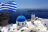 Santorini with flag of Greece, Fira capital town — Stock Photo