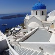 Santorini with flag of Greece, Fira capital town — Stock Photo #16790055