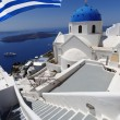 Santorini with flag of Greece, Fira capital town — Stock Photo #16790445