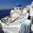 Santorini with flag of Greece, Fira capital town — Stock Photo #16790729