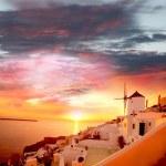 Windmill against colorful sunset, Santorini, Greece — Stock Photo #16799145
