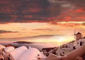 Windmill against colorful sunset, Santorini, Greece — Stock Photo