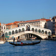 Venice, Rialto bridge and with gondola on Grand Canal, Italy — Stock Photo #16801175