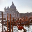 Venice with gondolas on canal in Italy — Stock Photo