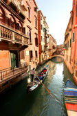 Venice with gondola on canal in Italy — Stock Photo